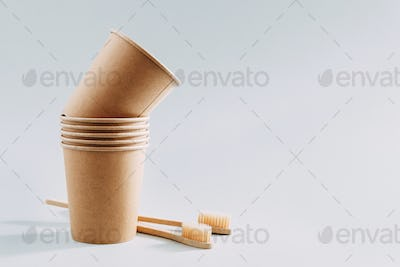 Zero waste concept with paper cups and toothbrushes
