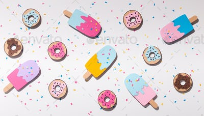 Sweet summer background with ice cream and donuts