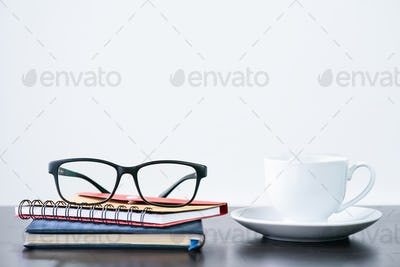 Coffee cup and eyeglasses on desk-2