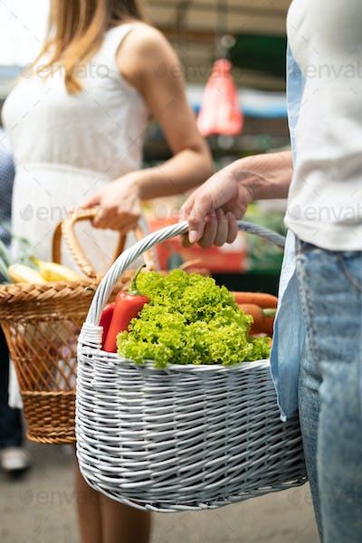 Beautiful women shopping vegetables and fruits on the market