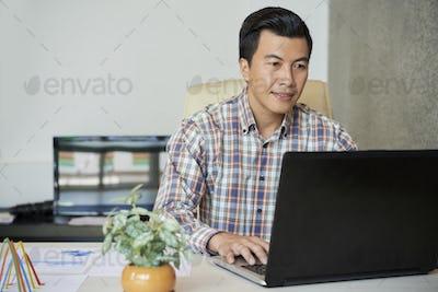 Entrepreneur working on laptop