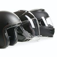 Three black motorcyle helmets