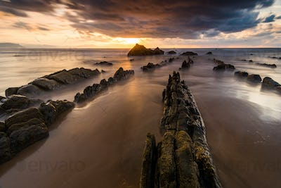 flysch rocks in barrika beach at the sunset