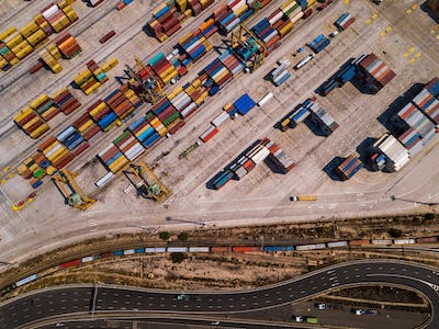 Industrial Cargo area with container ship in dock at port, Aerial view