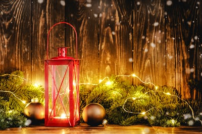 Christmas lantern with deco on wooden background
