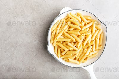 Cooked ready italian penne in white pan