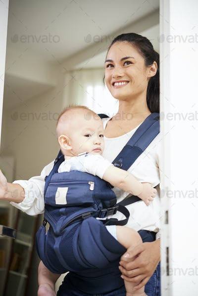 Young mother leaving house