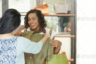 Friends choosing dress at store