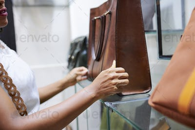 Woman looking at bag in store