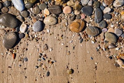 Beautiful pebbles on the beach close up