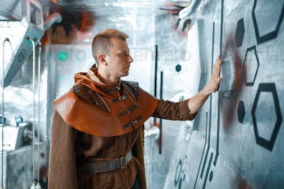Space scientist holds wires at the control panel