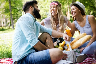 Summer, vacation, music and recreation time concept. Group of friends have picnic outdoor