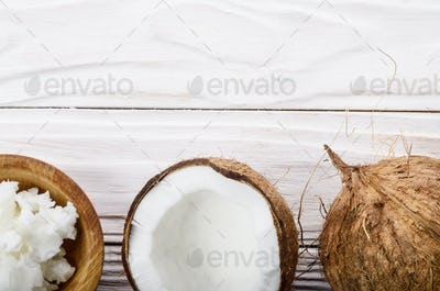 Flat lay background of coconut, coconut shell, hard oil in woode