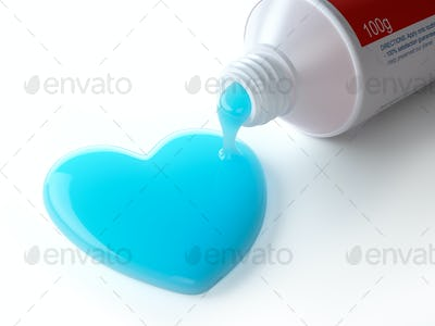 Toothpaste in the shape of heart coming out from toothpaste tube