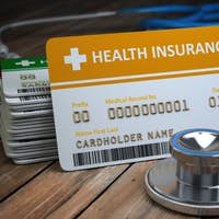 Health care medical Insurance card  and stethoscope as a symbol