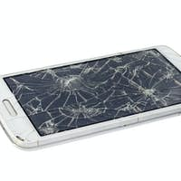 Broken smartphone isolated on white background