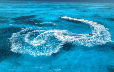 Aerial view of floating water scooter in blue water at sunny day