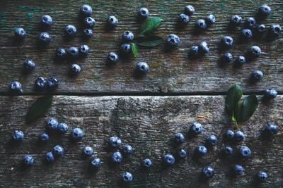Blueberries on vintage wooden background top view, healthy food on dark table, berry for smoothie
