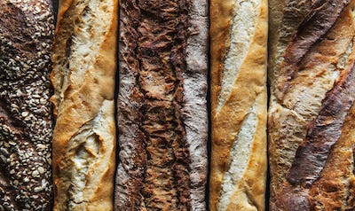 Baguette mix on a black background. French pastries, homemade