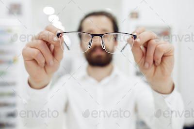 Handsome man in a optics shop