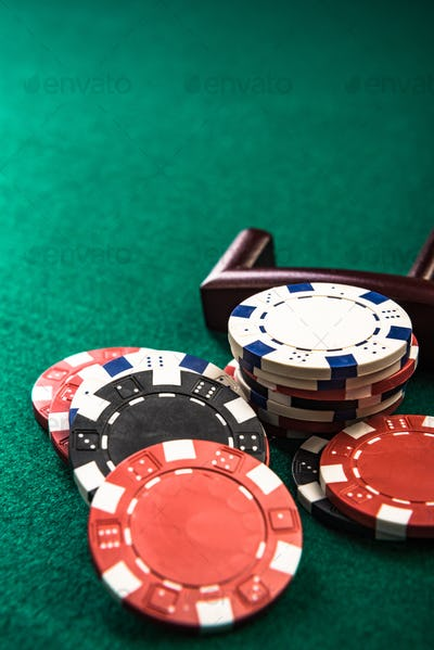 Poker or Roulette Casino Chips Close Up on Green Felt Casino Tab
