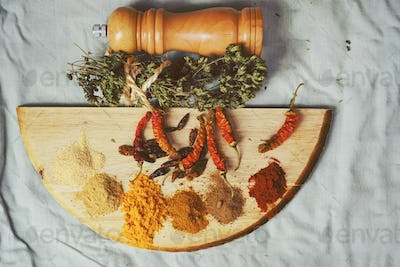Mix of indian spices in a wooden table
