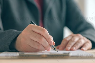 Close up of businesswoman hands signing contract and business ag