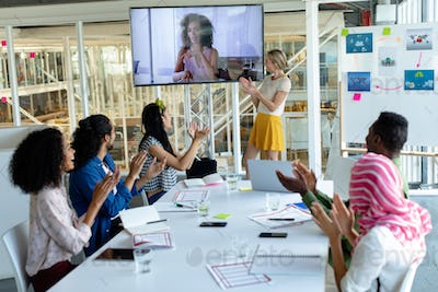 Diverse happy  business people applauding during video conference at conference room