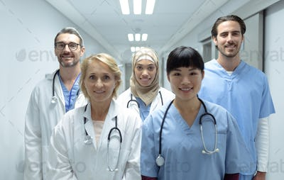 Portrait of diverse medical teams standing in the corridor at hospital
