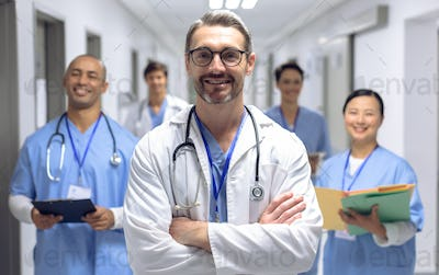 Diverse medical team of doctors looking at camera while holding clipboard and medical files