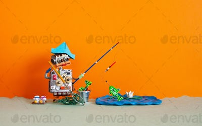 Angler robot toy caught big fish. Robotic fishing rest activity concept.