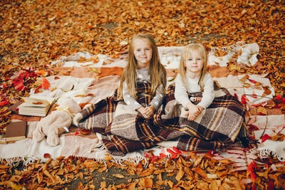 Cute little girls in a autumn park