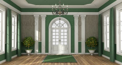 Green and brown home entrance of a luxury villa