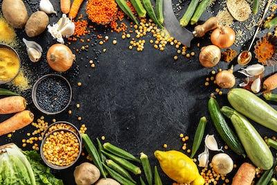 Variety of fresh tasty vegetables on dark background