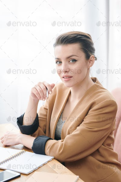 Confident lady keeping list of tasks