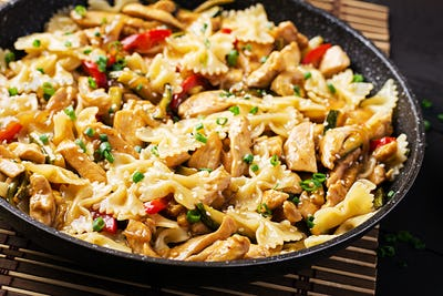 Stir fry chicken, pasta farfalle, zucchini, sweet peppers and gr