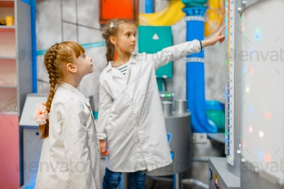 Children playing doctors in laboratory, playroom