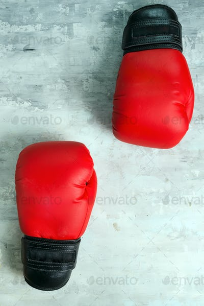 Pair red of boxing gloves on grey background