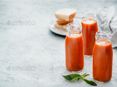 Gaspacho soup in glass bottles, copy space