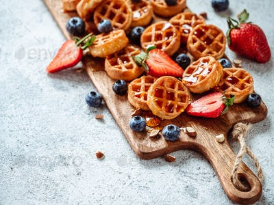 delicious soft belgian waffles with berries, copy space