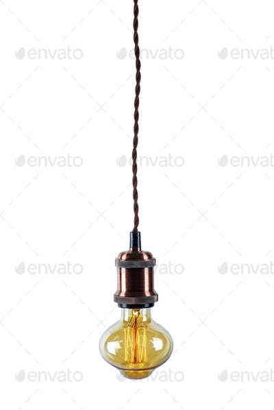 Glowing vintage light bulb isolated on white background