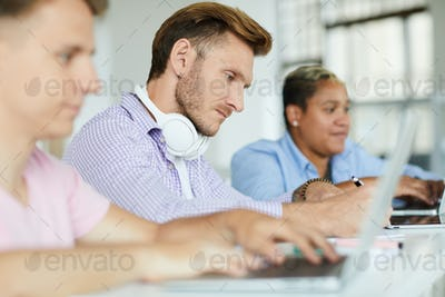 Concentrated guy analyzing information