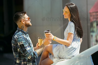 Young couple preparing for vacation trip on the car in sunny day