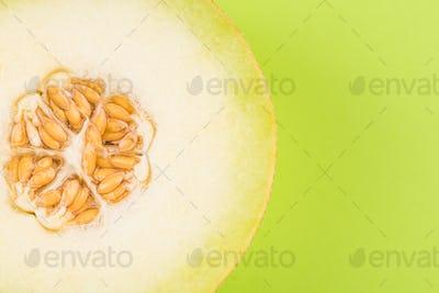 Honeydew Musk Melon Sliced in Half on Pastel Background