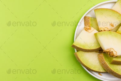 Honeydew Musk Melon Slices on Plate on Pastel Background, Servin