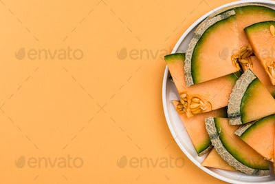 Sliced Cantaloupe Melon Served on Plate, Pastel Background , Bor