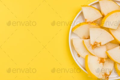 Sliced Yellow Musk Melon Served on Plate, Pastel Background and