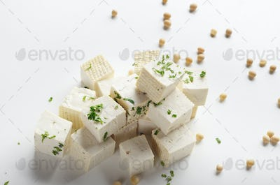 Soy Bean curd tofu with greens on white background Non-dairy alt