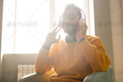 Carefree hipster guy in headphones