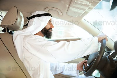 Arabian saudi businessman driving hir car